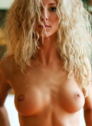 Slender body with large perky nipples.